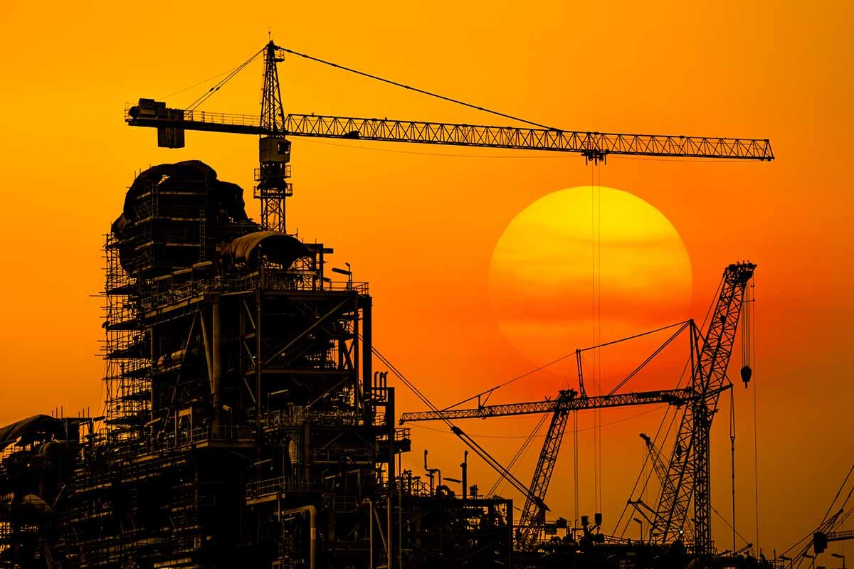 Oil refinery construction in silhouette, Industrial Oil refinery in building